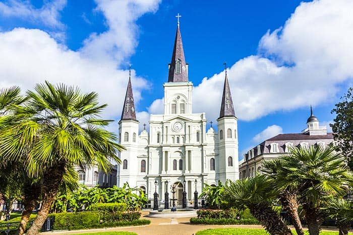 St. Louis Cathedral presides over bustling Jackson Square. Click through to read the top 10 things to do in New Orleans!
