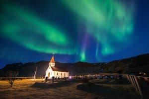 Vik i Myrdal Church And Aurora Borealis In Vik, Iceland.