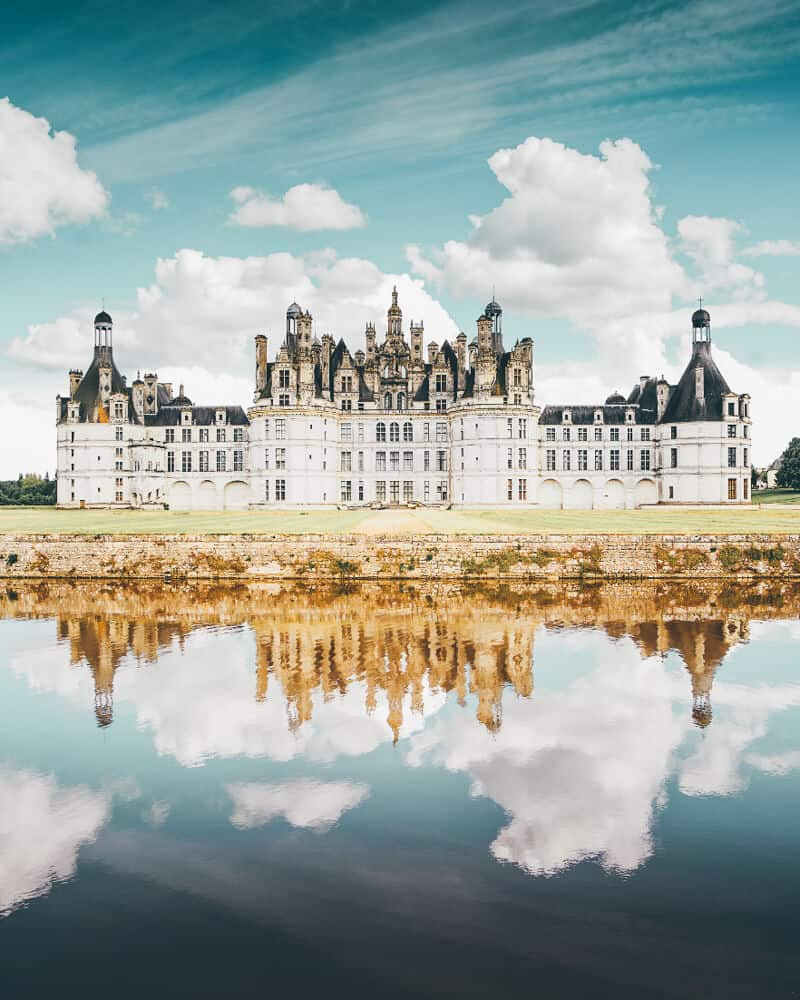 Chateau de Chambord, France - Most people realize the Chateau de Chambord in France is large, but most people don't realize just how large. It contains 440 rooms and 365 fireplaces. Check out 20 of the most beautiful castles in the world on avenlylanetravel.com #AVENLYLANETRAVEL #AVENLYLANE #castles #europe #travel #travelinspiration #beautifulplaces #beautifulphotos