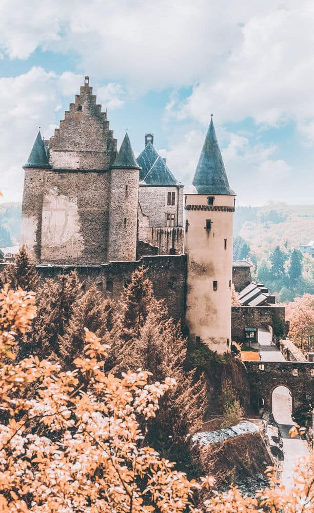 Vianden castle in Luxembourg sits on top of the city.  Also worth noting is that even in modern warfare, this castle was used in defense against the Nazis. Check out 20 of the most beautiful castles in the world on avenlylanetravel.com #AVENLYLANETRAVEL #AVENLYLANE #castles #europe #travel #travelinspiration #beautifulplaces #beautifulphotos