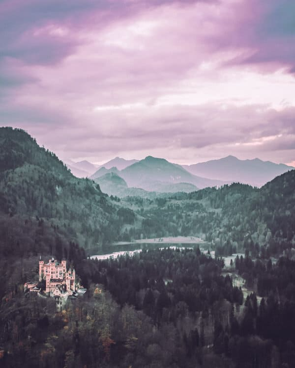 The Bavarian Alps with Hohenschwangau, Germany. Of all the beautiful castles in Germany, I would have to say this one is my favorite!  This German castle near the town of Fussen amazingly received no damage in World War I or World War II. Check out 20 of the most beautiful castles in the world on avenlylanetravel.com #AVENLYLANETRAVEL #AVENLYLANE #castles #europe #travel #travelinspiration #beautifulplaces #beautifulphotos