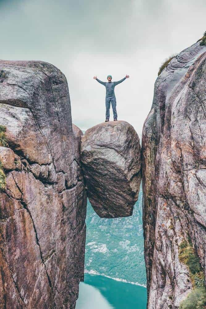The Hanging Stone in Norway! Not sure I would be brave enough to walk on this.  What about you? Seven Sister Falls. in one of the most famous fjords in Norway! Norway is one of the most breathtakingly beautiful countries in the world and these photos prove it! So amazing! Here are some of the top places to see in Norway. #norway #norwayphtoos #norwayphotography #avenlylanetravel #avenlylane #europe #travelinspiration #beautifulplaces