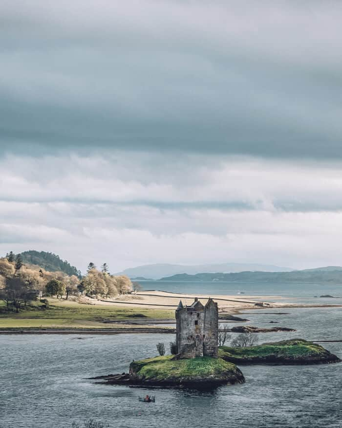 Castle Stalker, Appin. The Best Castles in Scotland! Between the Scottish Highlands and the gorgeous city of Edinburgh Scotland is one the of most beautiful places on earth. These 15 Scottish castles will be perfect to add to your Eurppe Bucket List! #scotland #castles #scottishhighlands #edinburgh #Unitedkingom #travel #bucketlist #europe #traveltips #beautiful #travelblog #avenlylane #avenlylanetravel