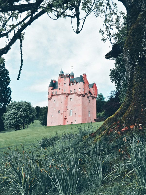 Craigievar Castle in Scotland. One of the best castles in Scotland. Pictures of Scotland you will want to add to your Scotland road trip itinerary! Europe Bucket List - #avenlylanetravel #scotland #travel #scottishhighlands #unitedkingdom #hiking #adventuretravel #adventure #river #outdoors #travelitinerary #roadtrip #scottish - Read the full article at www.avenlylane.com #castles