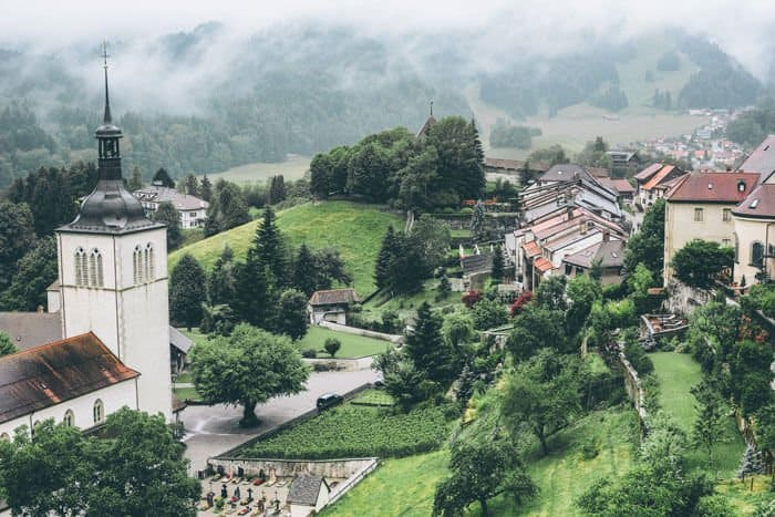 Gruyeres Switzerland is most famous for its famous cheese of the same name, but there are many additional reasons to visit this historic town. Most obvious is the castle, which sits on a hilltop and rises high above the other centuries-old buildings.