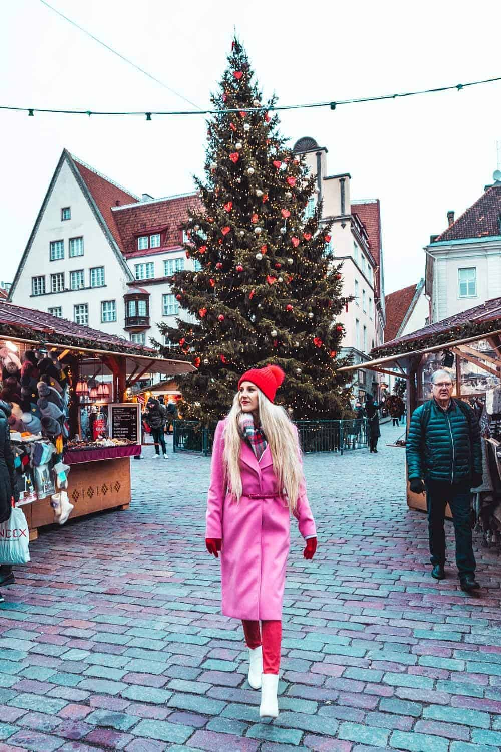 Tallinn Christmas Market at Raekoja Plats. Best things to do in Tallinn Estonia! If you are planning on traveling to Europe you need to check out Tallinn. It is one of the most beautiful cities in Europe.