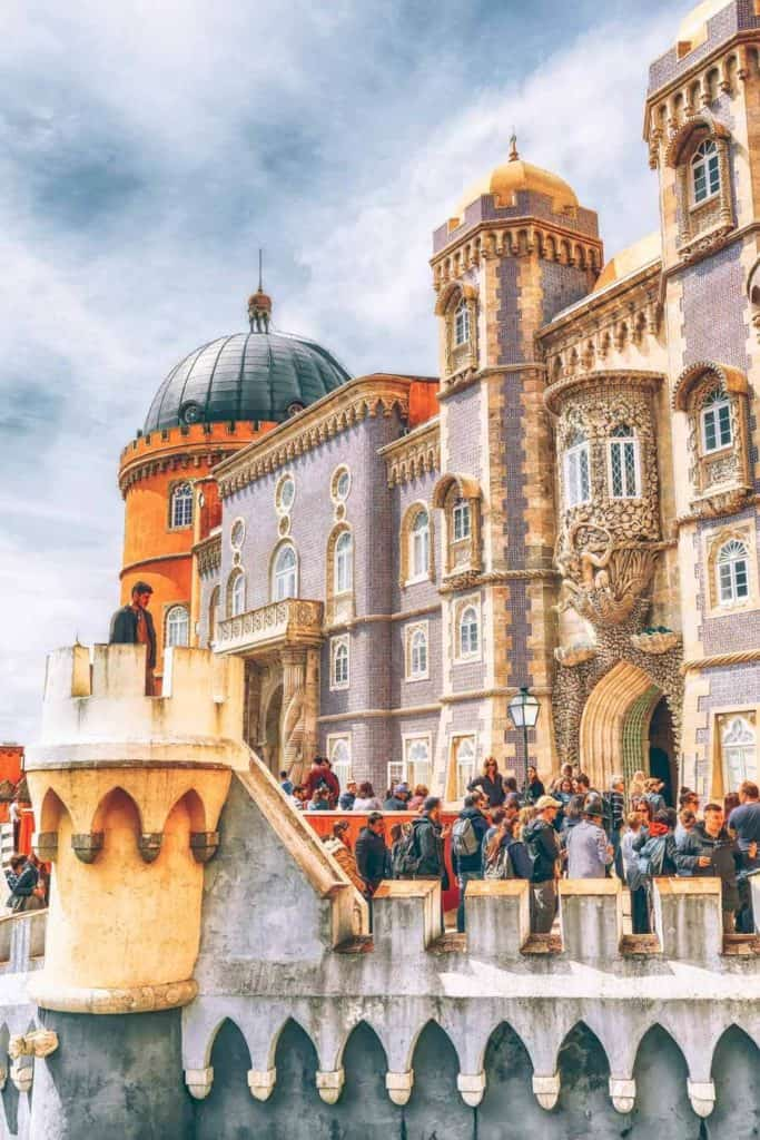 The beautiful Pena Palace in Sintra Portugal. Par of the perfect day trip from Lisbon Portugal. #avenlylanetravel #avenlylane