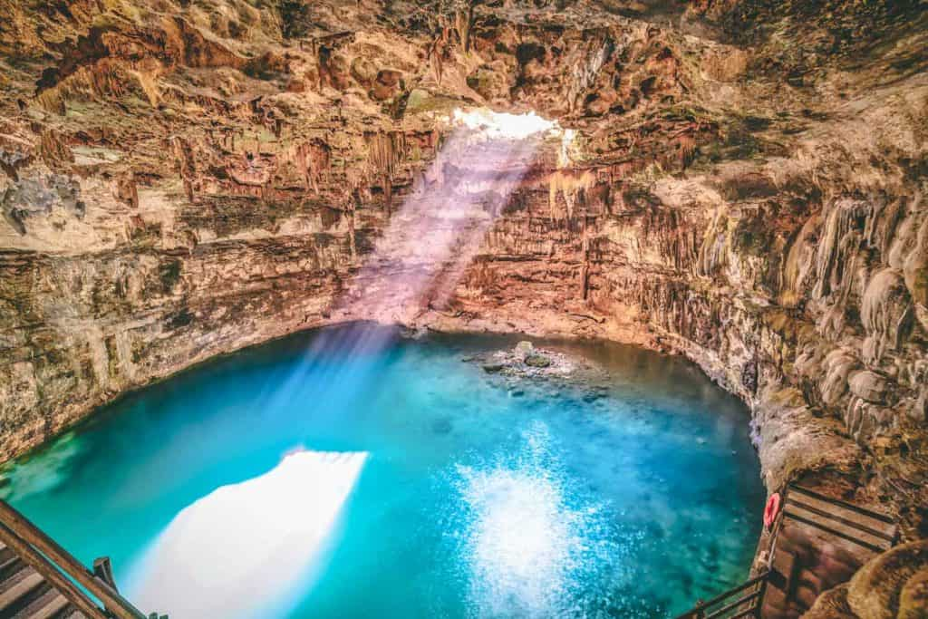 Cenote Samula sinkhole light beam near Valladolid in Yucatan Mexico
